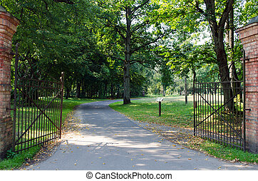 large antique gate in the park - large antique gate open ...