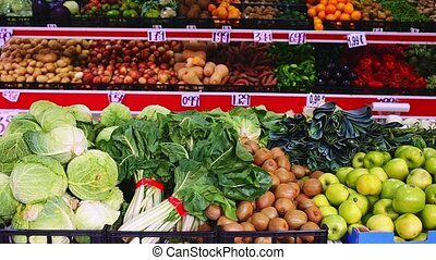 Shelves with variety testy vitamin products in fruit and vegetables department in the supermarket