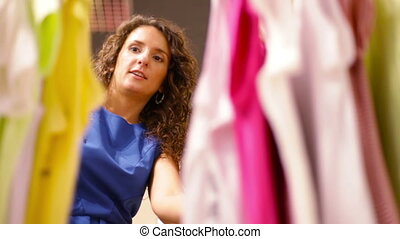 Large assortment - Elegant ladies being busy with choosing a...