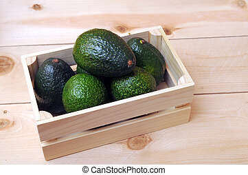 large avocado in wooden case