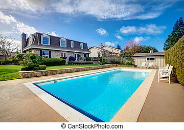 Large backyard with flowerbed and swimming pool - Two story...