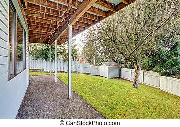 large backyard with grass.