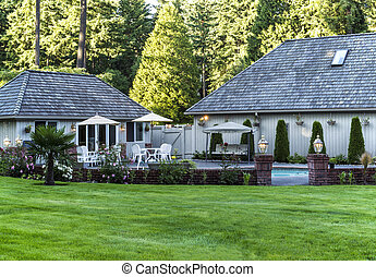 Large backyard with plush green grass, trees, pool and home in background