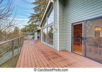 Large balcony with fenced garden view