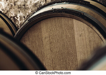 large barrels close-up - Barrels of wine in a wine cellar,...