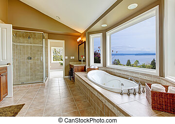 Large bath tun with water view and luxury bathroom interior....