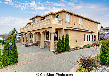 Large beautiful home with beamed balcony.