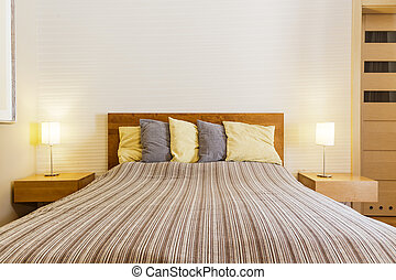 Large bed in a modern bedroom