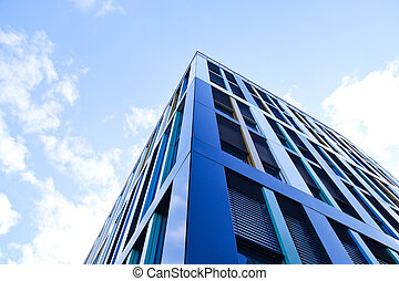 Large blue building with the sky above