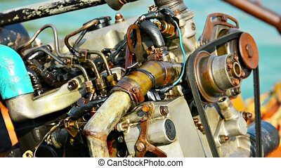Large Boat Engine Exposed in the Tropical Sun