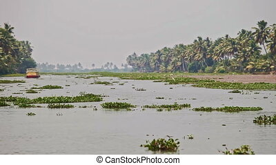 Large Boat Sails along Wide River by Palms Bank in Tropics -...