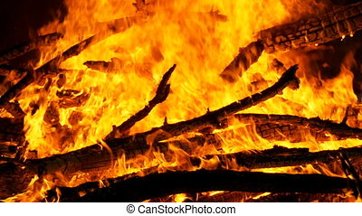 Large Bonfire Burning at Night - Large Bonfire brightly...