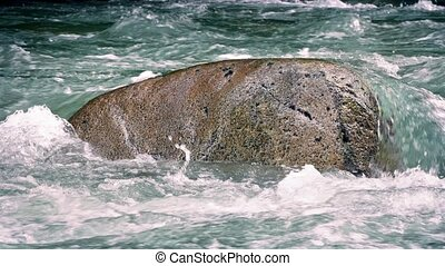 Large Boulder In The River - Single large boulder standing...