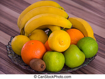 Large bowl with apples, oranges, bananas and other fruits