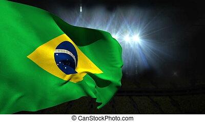 Large brazil national flag waving on black background with...