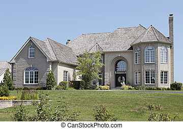 Large brick home with arched entry