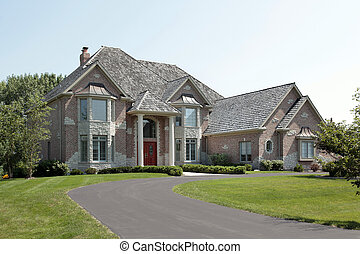 Large brick home with red door