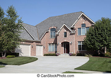 Large brick home with three car garage