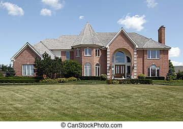 Large brick home with turret