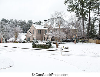 Large Brick House in the Snow