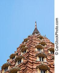 Large brick pagoda with the many window.
