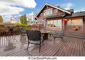 Large brown house with back deck exterior rain winter shot