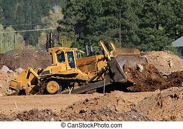 large bulldozer - large yellow bulldozer moves soil at a ...