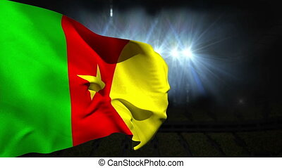Large cameroon national flag waving on black background with...
