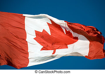 Large Canadian flag blowing in the wind - a closeup.