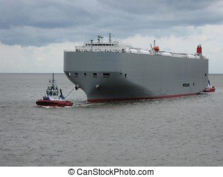 Large car carrier and tug