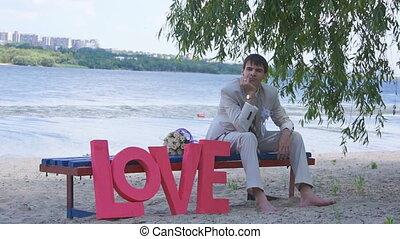 Large cardboard letters on wedding, slider camera