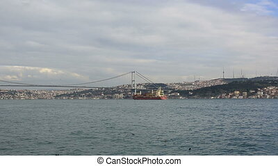 large cargo ship - large container ship passing Bosphorus...