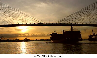 Large Cargo Shipping Boat at sunrising