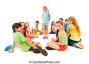 Large circle of kids and little girl in the middle