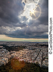 Large city of Athens against dramatic sky in Greece