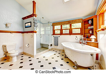 Large classic blue bathroom interior with tub and tiles. -...
