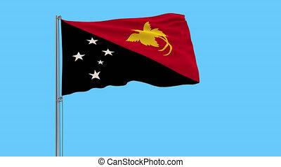 Large cloth Isolate flag of Papua New Guinea on a flagpole,...