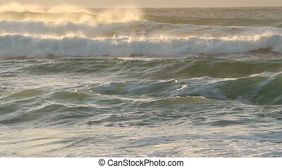 Large coastal waves and water spray with strong winds at...