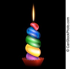 large colored candle - black background and the large...