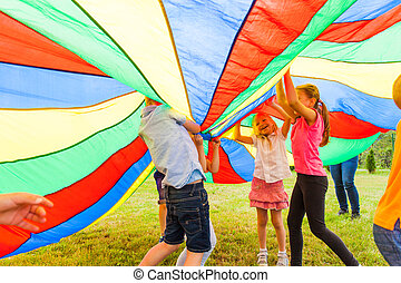 Large colorful cloth covered group of friends