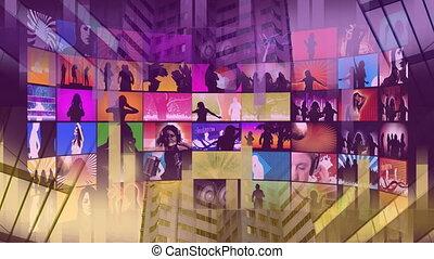 Large colorful screens displaying women dancing