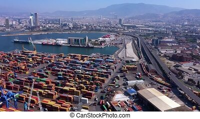 Large commercial port. Loading ships in the port top view. Economic hub of the country.
