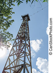 Large communication tower against the sky.