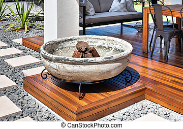 Large concrete pot with wood on the wooden floor
