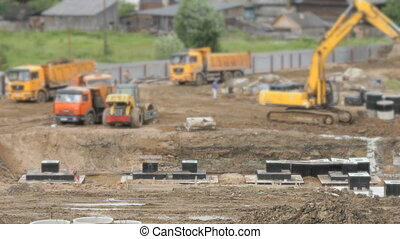 Large construction of large complex of buildings. Yellow...