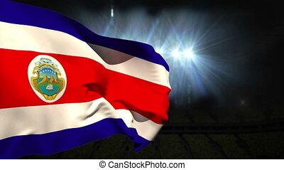 Large costa rica national flag waving on black background...