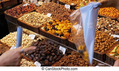Large Counter of Dried Fruits and Nuts at a Farmers Market...