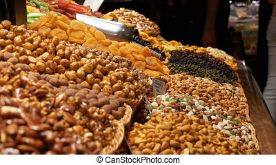 Large Counter of Dried Fruits and Nuts at a Market in La...