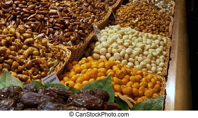 Large Counter of Dried Fruits, Nuts and Sweets at a Market...