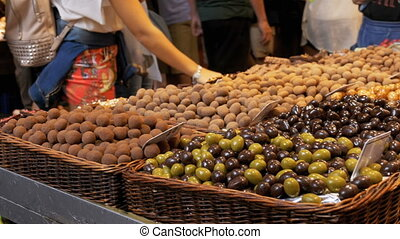Large Counter of Sweets with Chocolate Candy in La Boqueria...